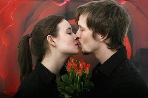 Cancer woman kissing her Virgo man